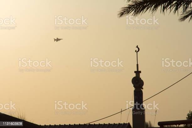 Mirage 2000 flying over above mosque