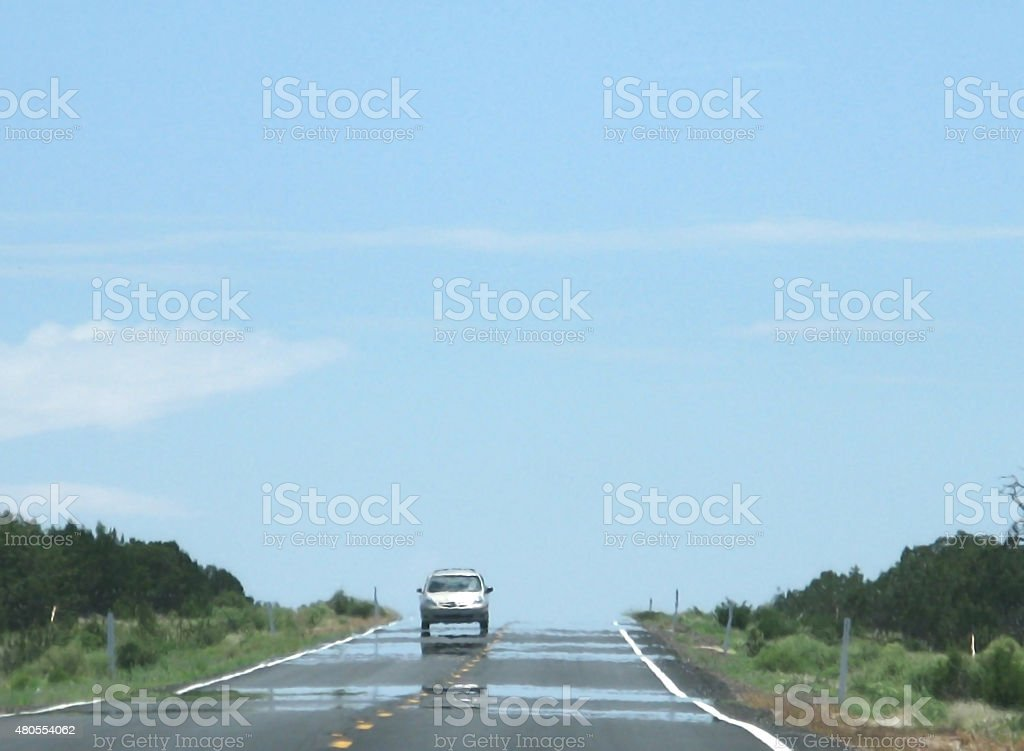 Mirage on highway stock photo