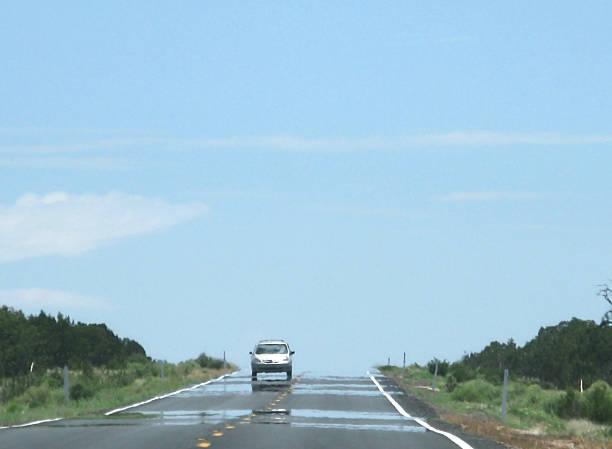 Mirage on highway stock photo