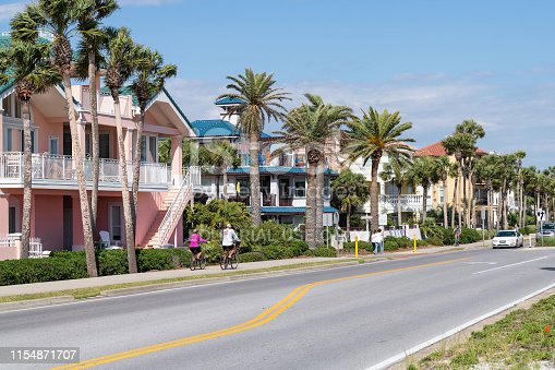 Destin, USA - April 24, 2018: Miramar beach city town village with colorful multicolored yellow beachfront houses in Florida panhandle gulf of mexico, coast highway road street