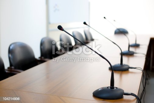 istock Mircophones in board room close-up 104214936