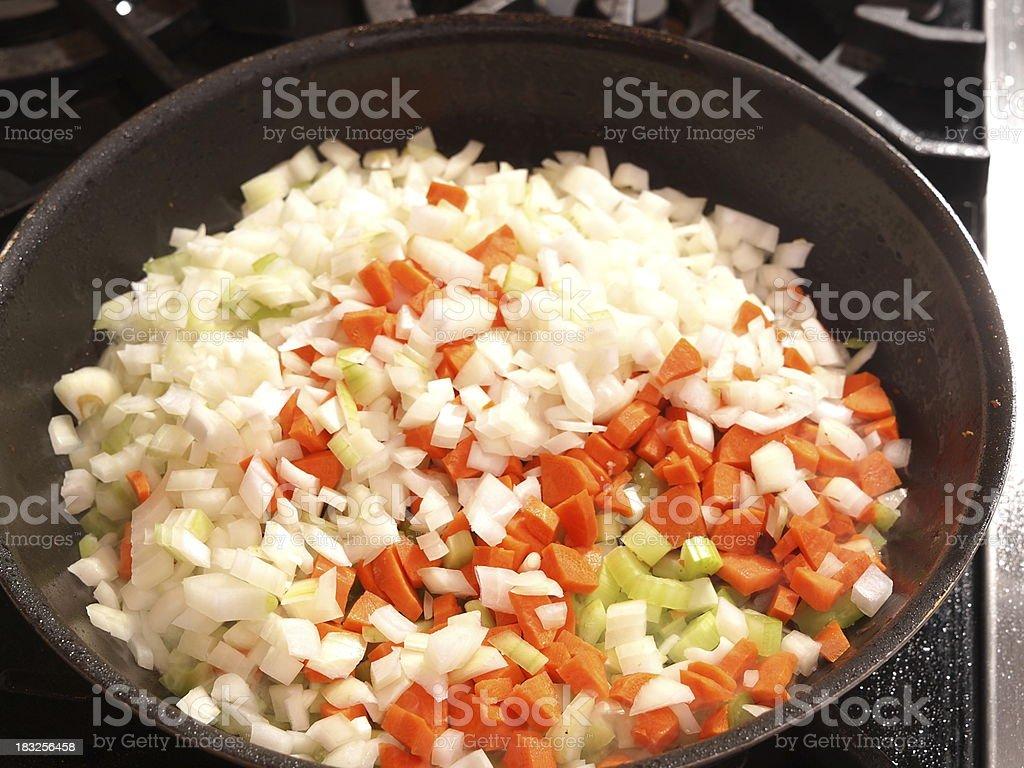 Mirepoix in skillet carrot,celery,onion stock photo