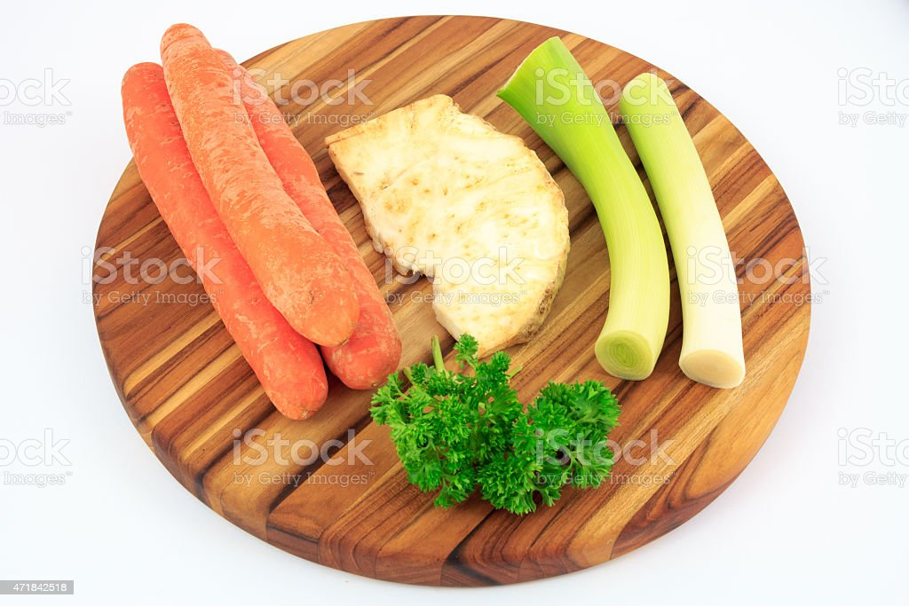 Mirepoix on wooden cutting board with white background stock photo