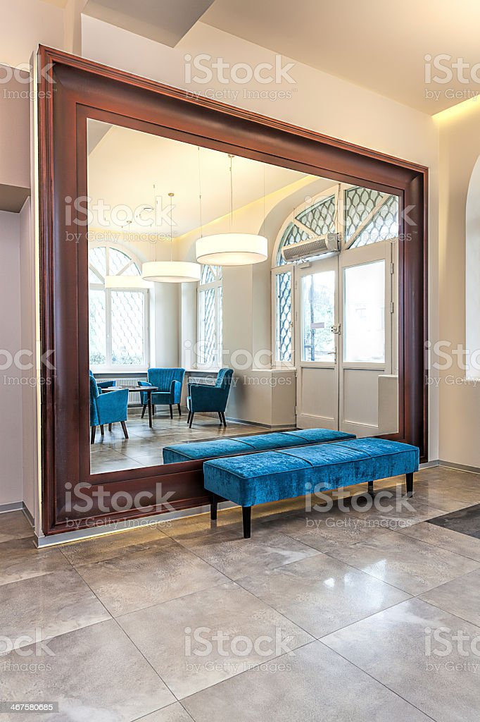 Mirror and a pouf royalty-free stock photo