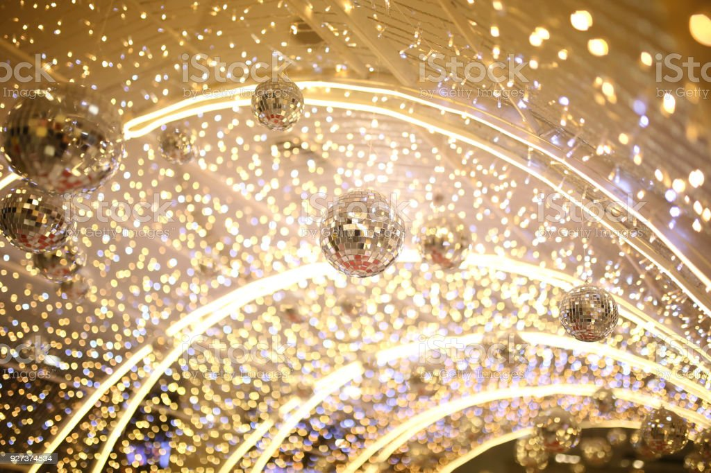 mirror disco ball hang on ceiling entrance tunnel with many small party light background, entertainment and enjoy night life star concert. mirror disco ball hang on ceiling entrance tunnel with many small party light background, entertainment and enjoy night life star concert concept Bright Stock Photo