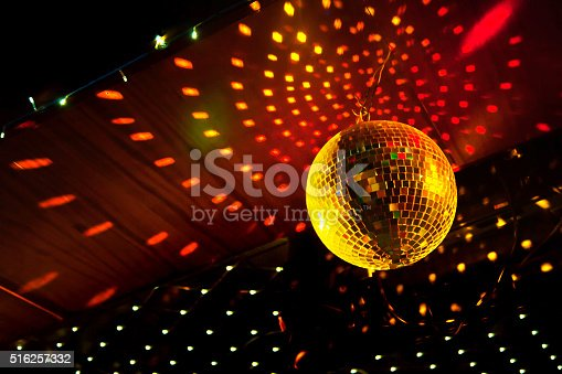 istock Mirror disco ball with light reflection on the ceiling 516257332