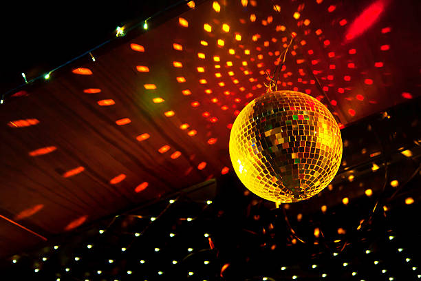 Mirror disco ball with light reflection on the ceiling stock photo