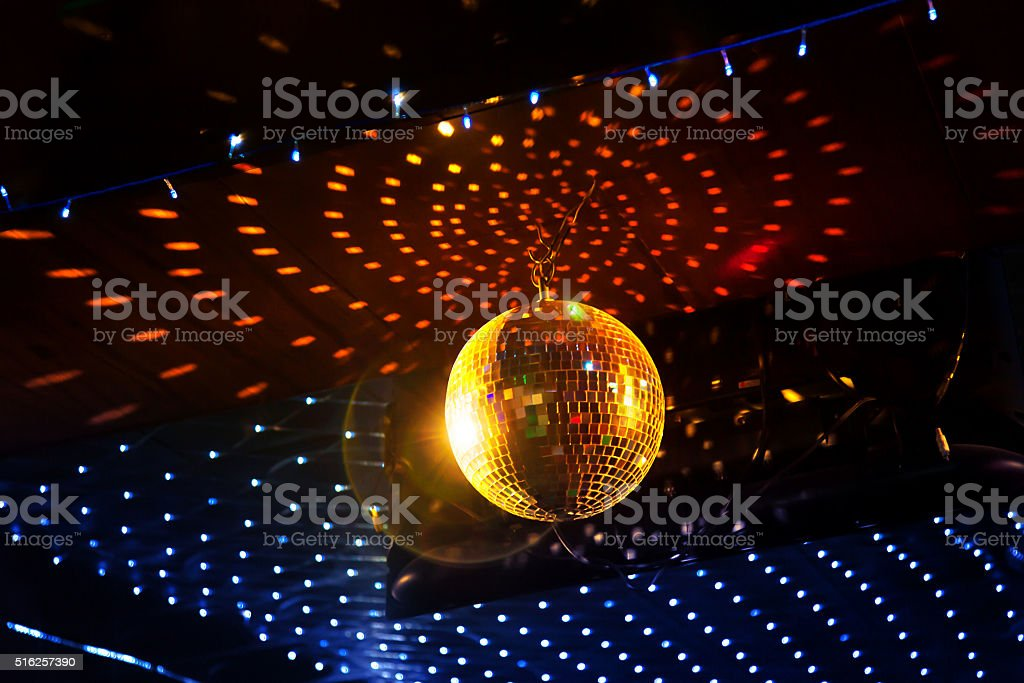 Mirror disco ball with light reflection on the ceiling stock photo mirror disco ball with light reflection on the ceiling royalty free stock photo aloadofball Images