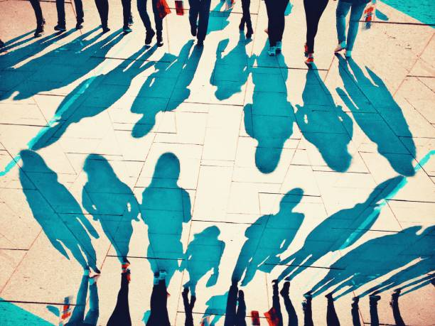 Mirror effect of crowded people shadows walking