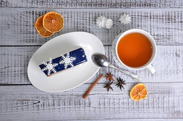 mirror glaze mousse cake with winter decoration stock photo
