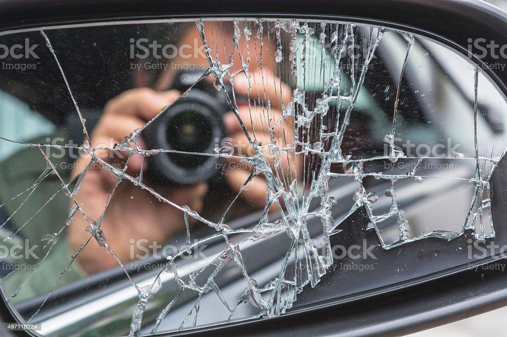Mirror Image in broken mirror stock photo