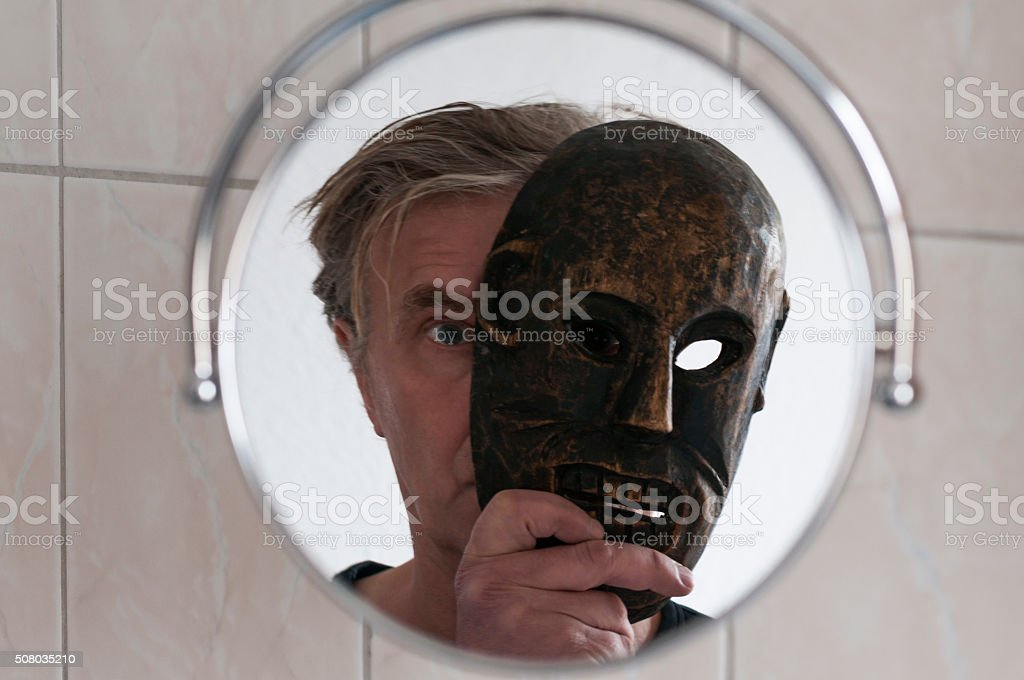 Mirror image, man with mask stock photo