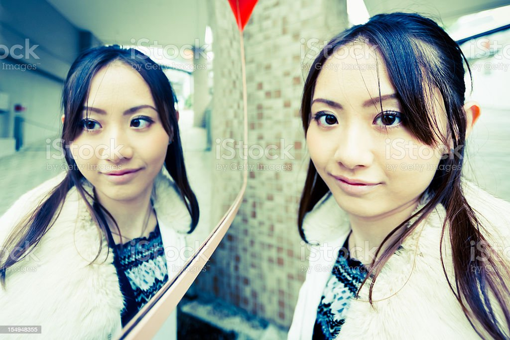 Mirror Image Urban Young Woman Portrait royalty-free stock photo