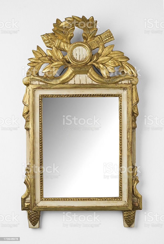 Mirror in a golden frame stock photo