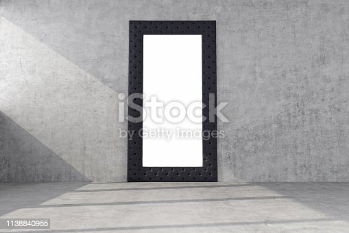 istock mirror in a wide black frame on a concrete wall 1138840955