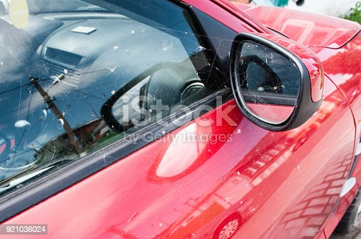 837409978istockphoto Mirror of red car 921036024
