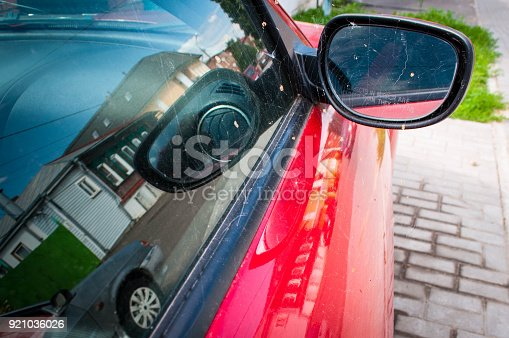 837409978istockphoto Mirror of red car 921036026