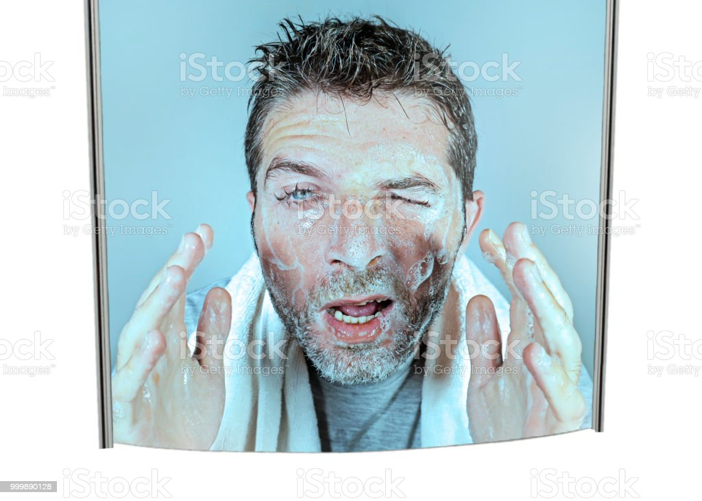 Mirror Reflection Portrait Of Young Attractive And Funny Man