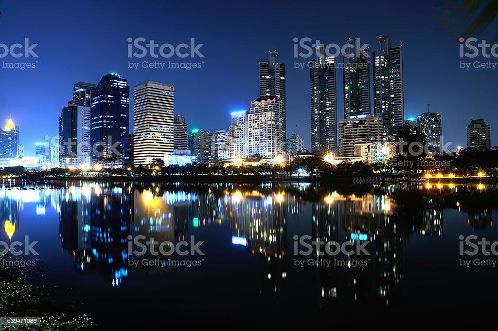 mirror water with night city Bangkok Thailand stock photo