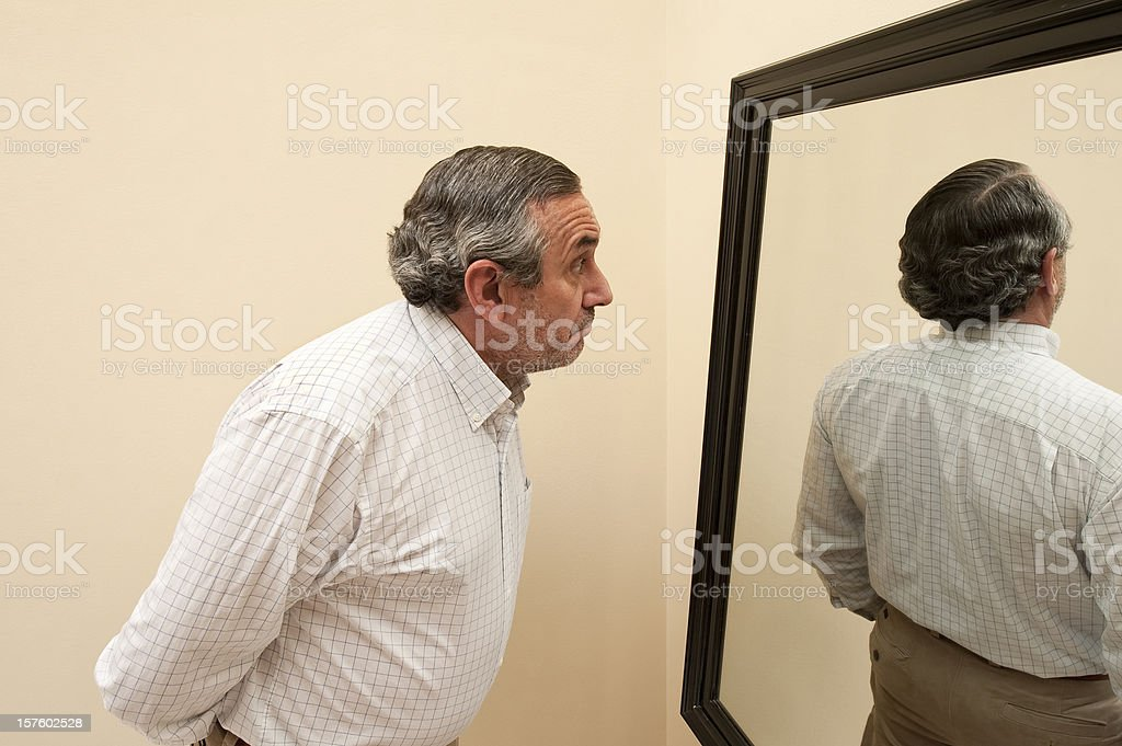 Mirror with bizarre reflection. stock photo