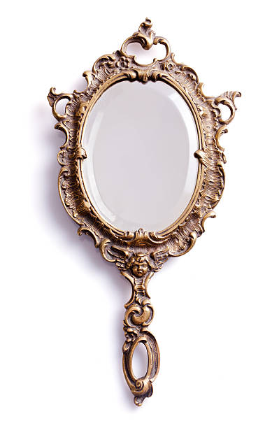 Mirror with golden handle and frame stock photo