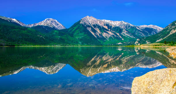 Mirrored Reflection of Rocky Mountains Highest Peak in Colorado Mount Elbert and Twin Peaks stock photo
