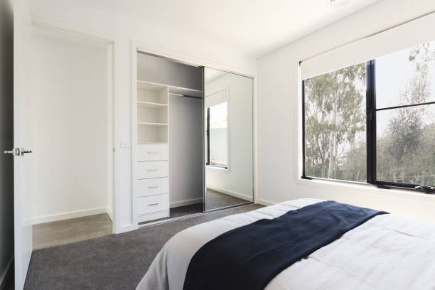 Mirrored wardrobe detail in a bedroom with a view stock photo
