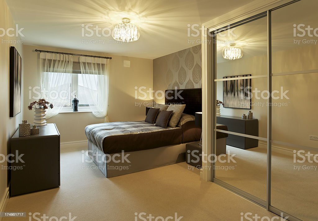 mirrored wardrobes and bedroom stock photo