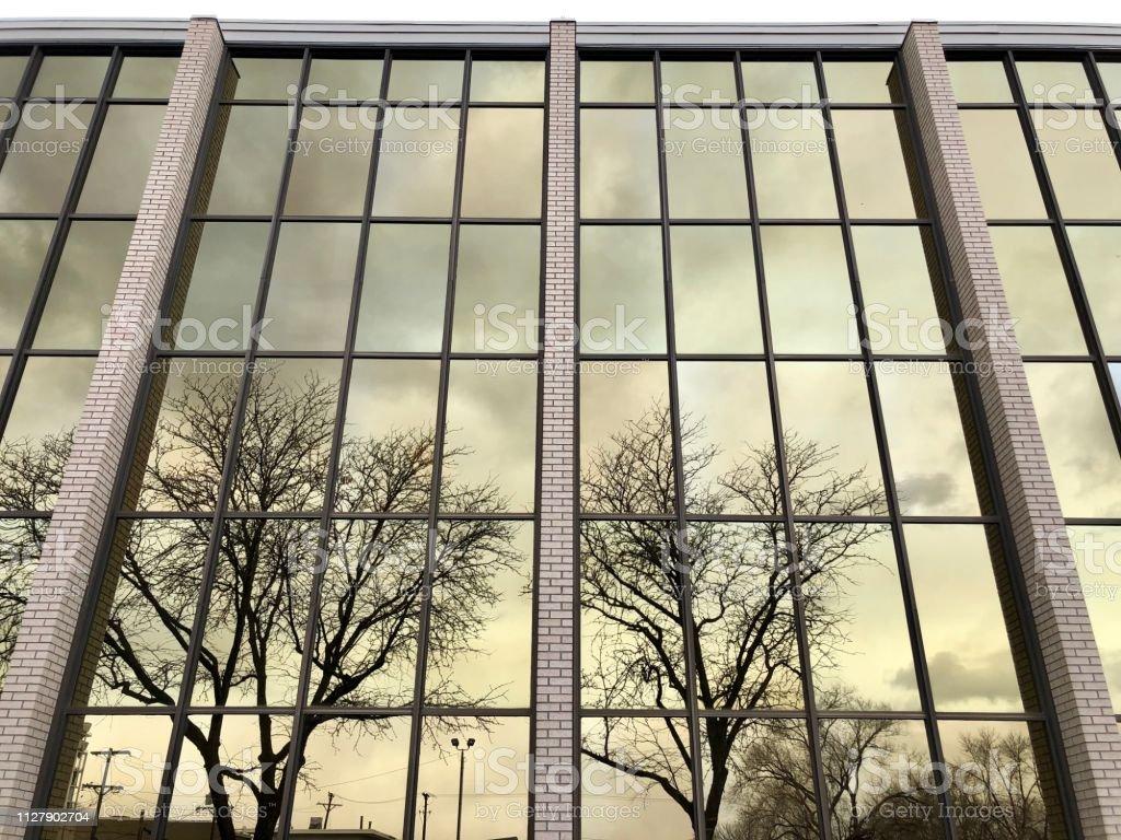 Mirrored Windows Reflect Dreary Skies stock photo