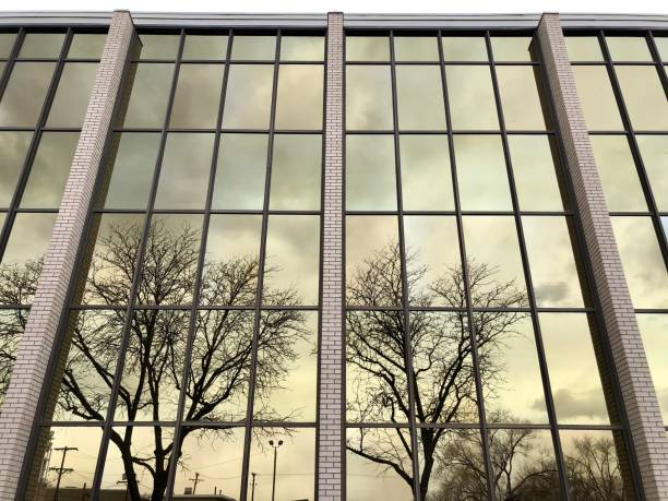 Mirrored Windows Reflect Dreary Skies stock photo