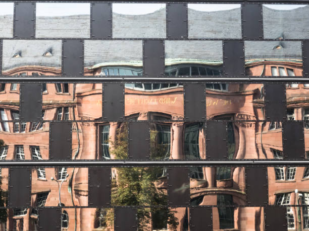 Mirroring of the facade of an old building in the windows of a modern building Mirroring of the facade of an old building in the windows of a modern building. antipode stock pictures, royalty-free photos & images