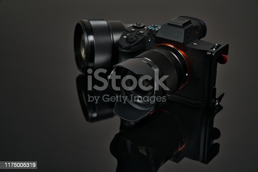 Mirrrorless Camera with Reflection on Black Color Background