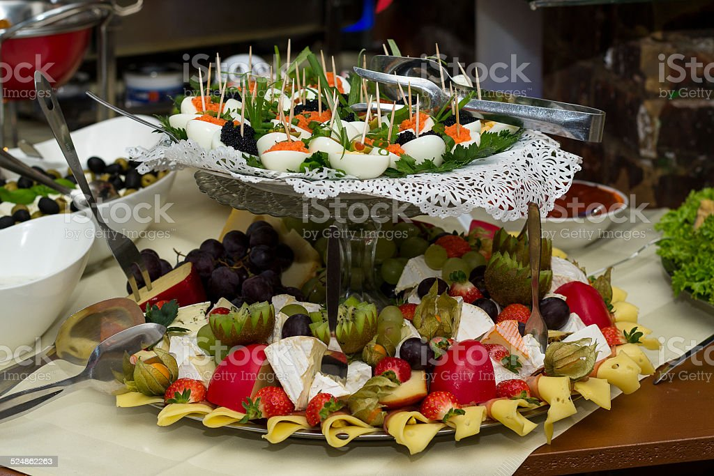 Miscellaneous finger food on a cake stand stock photo