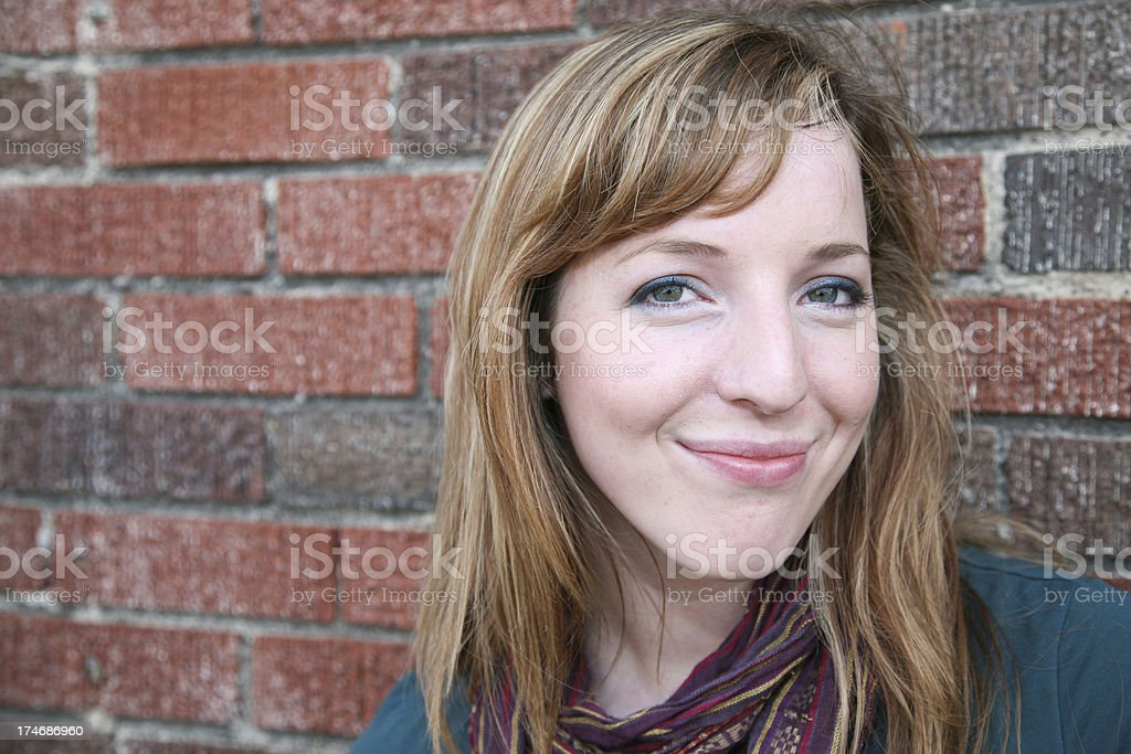 Mischevious Young Woman In An Urban Scene stock photo