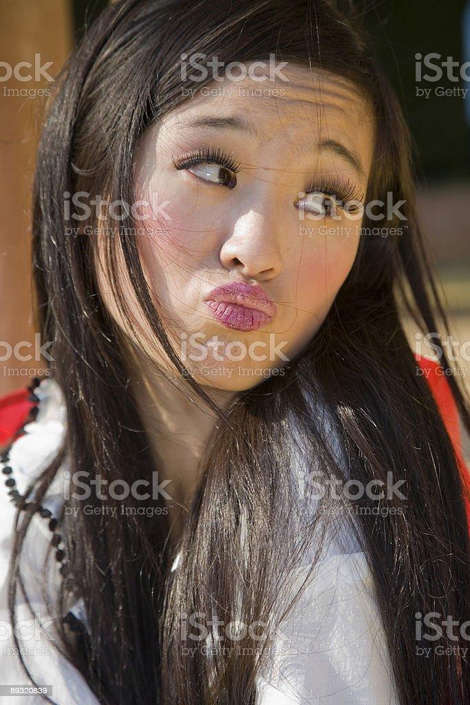 Mischievous asian woman stock photo