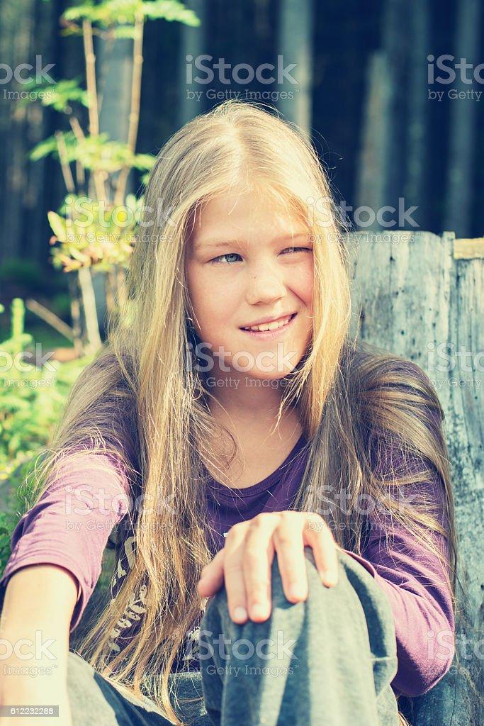 Mischievous little blonde stock photo