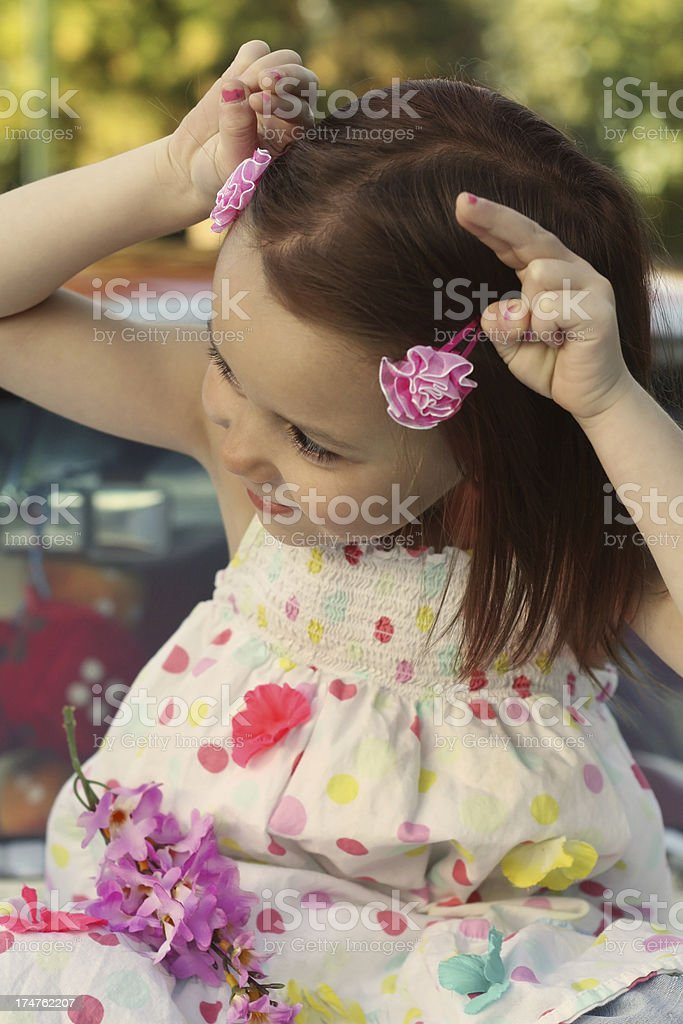 Mischievous Little Girl Making Devil Horns royalty-free stock photo