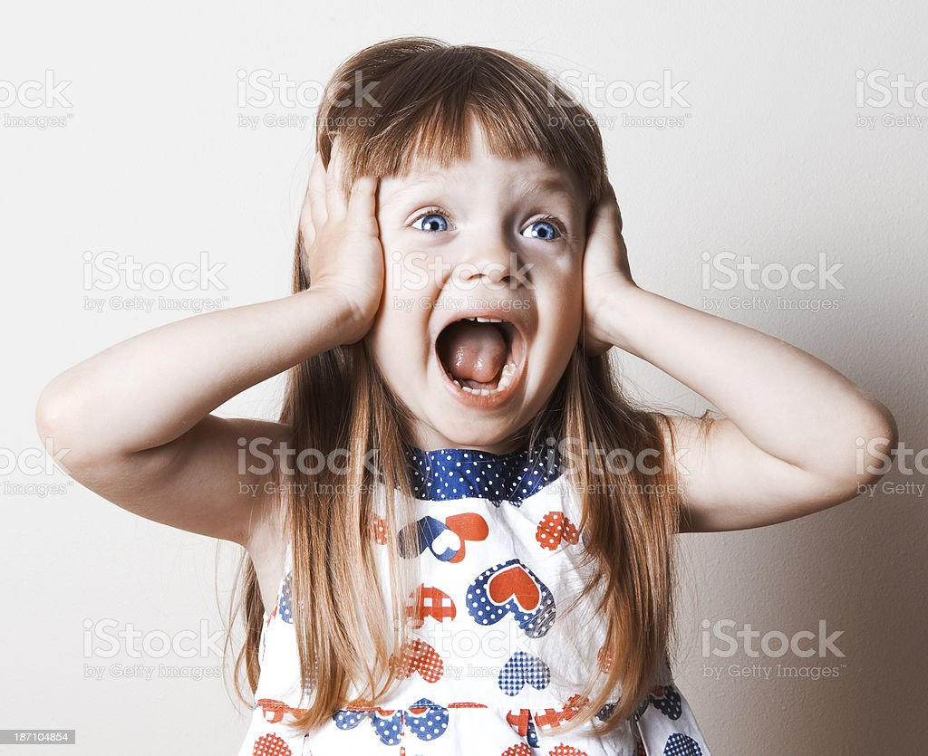 Mischievous little girl stock photo