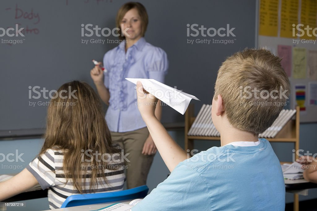 Mischievous Student In the Classroom stock photo