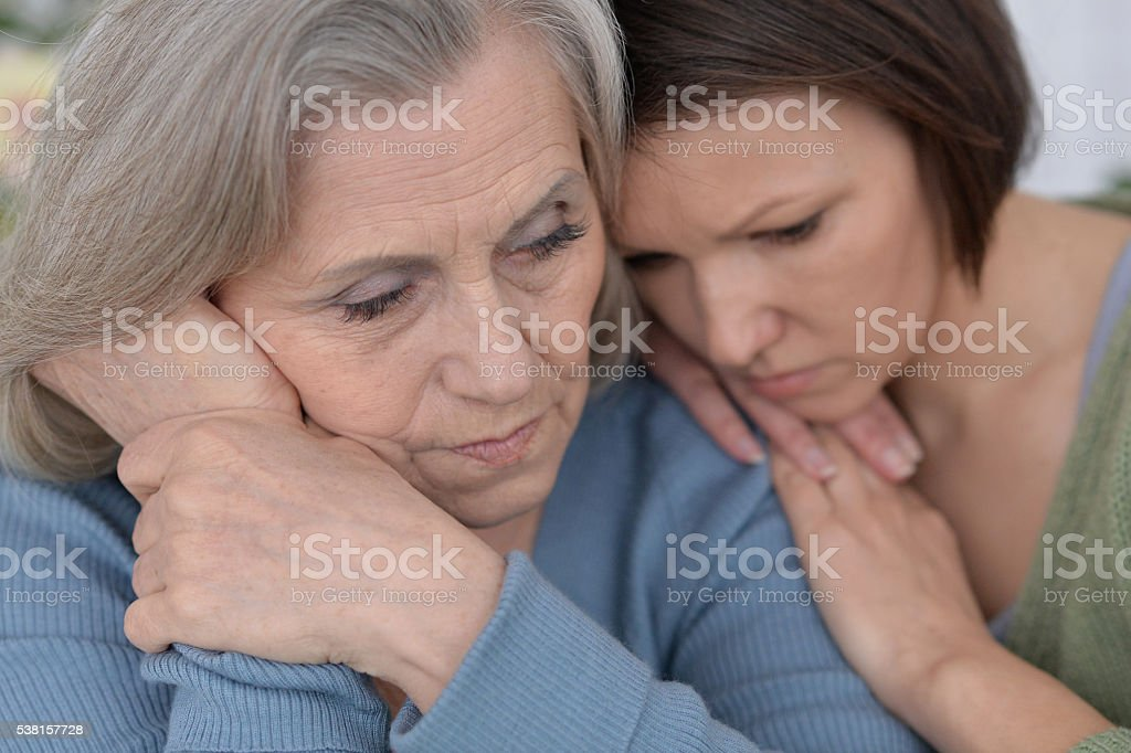 miserable mother and adult daughter stock photo