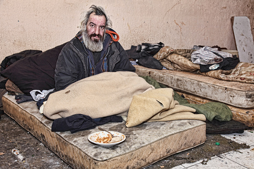 Poor man living in abandoned house