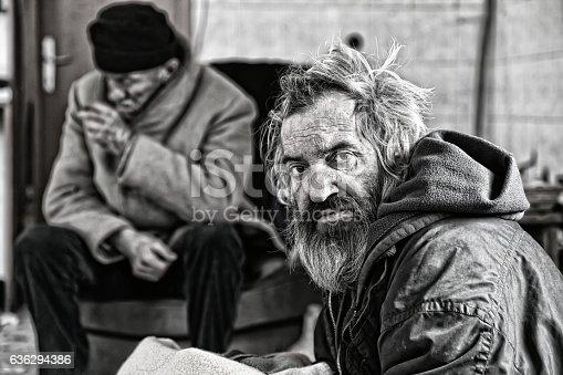 Poor men live in abandoned house
