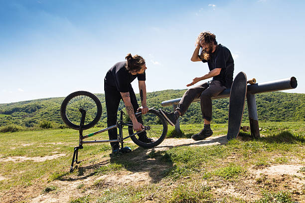 Misfortune with bmx bicycle in nature! stock photo