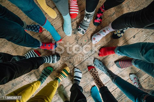 Taken when an office came together to support World Down Syndrome Day 2019. Part of the #LotsOfSocks campagne, this image looks down at a circle of mismatched socks! Patterns of every colour stand side by side showing friendship and unity.
