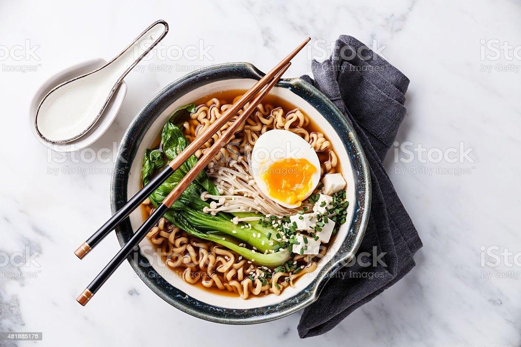 Miso Ramen Asian noodles with egg, enoki and pak choi stock photo