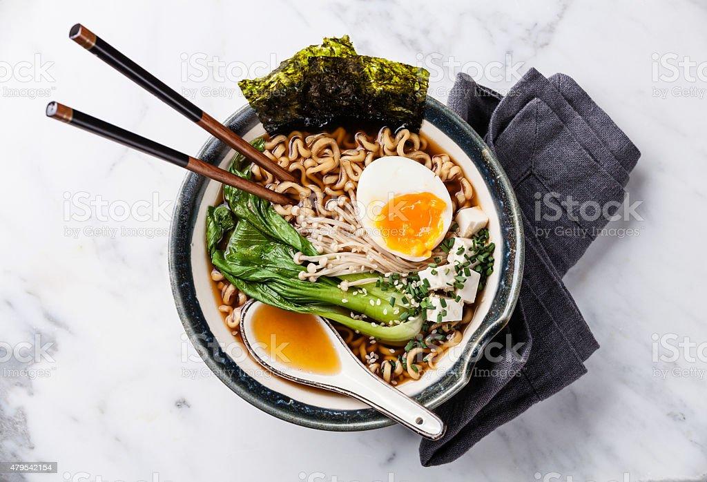 Miso Ramen noodles with egg, enoki and pak choi stock photo