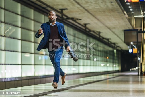African American businessman waiting for train