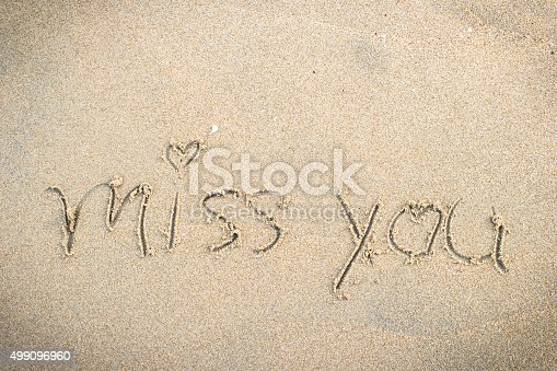Miss you handwritten in sand for natural, symbol,tourism or conceptual designs