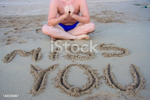 Young man sitting on the beach