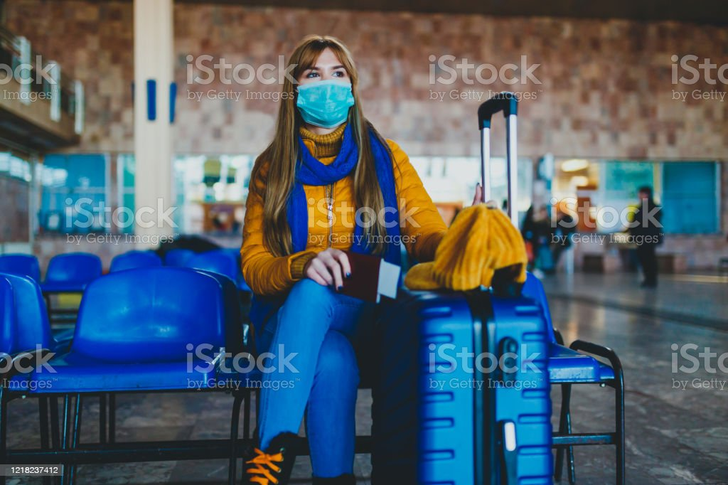 Missed or canceled transport due to a coronavirus Woman at station waiting for missed or canceled transport due to a coronavirus Adult Stock Photo